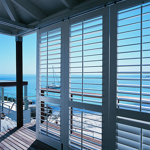 White Exterior Shutters on Deck Patio